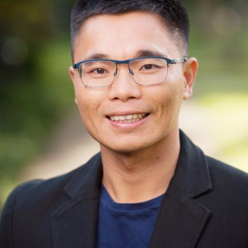 Headshot of Cary Wu smiling into the camera