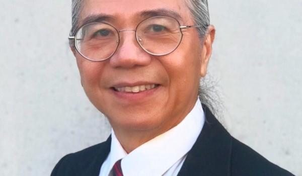 Headshot of Peter Bok, musician and music teacher, smiling.