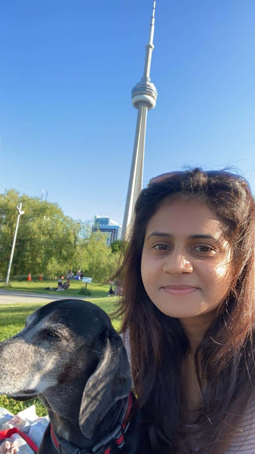 Selfie of permanent resident Marushka Loshki Nair with CN tower in the background
