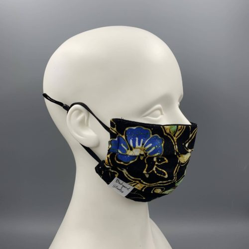 mannequin wearing floral patterned mask by Backyard Studios