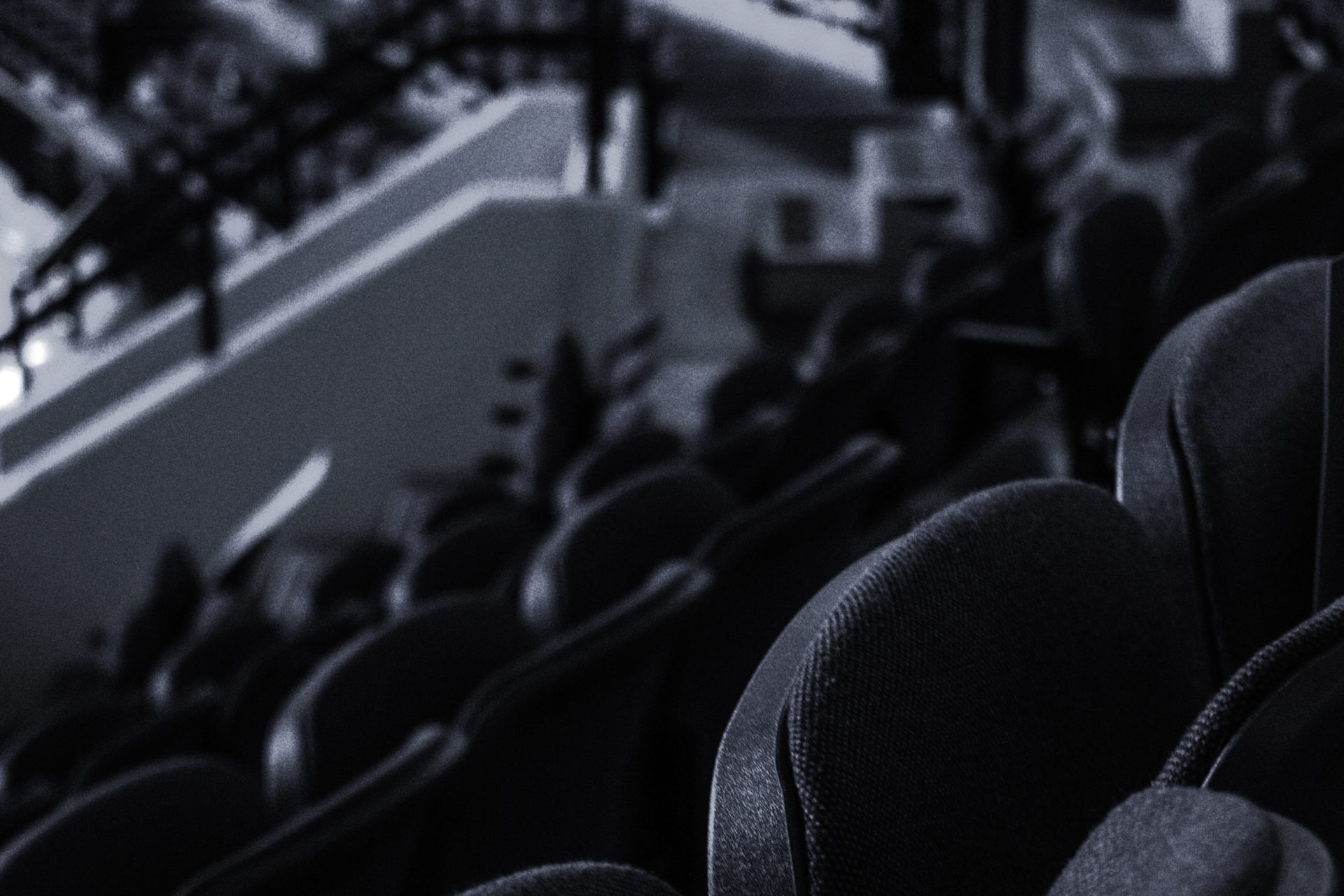 Why the NWHL Bubble burst. Black and white photo of empty hockey stadium.