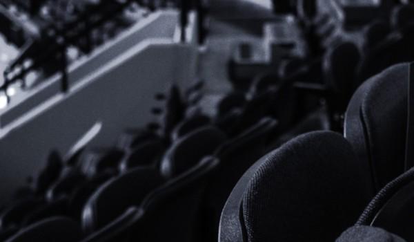 Why the NWHL Bubble burst. Black and white photo of empty hockey stadium.