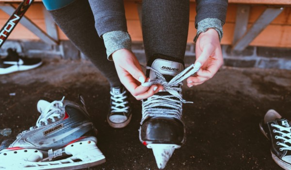 Photo of hockey player lacing up their skates