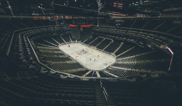 empty arena with players on the ice