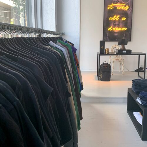 Shirts on a rack in a white painted store