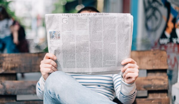 a person reading journalists work